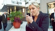 French far-right National Front leader and presidential candidate Marine Le Pen lights a cigarette outside her hotel in Washington,DC on November 2, 2011 at the start of her three-day visit to the US.     AFP PHOTO/Nicholas KAMM