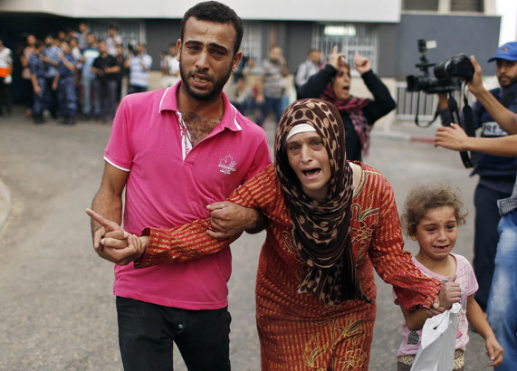 Palestinian woman reacts after the death of her relatives, who medics said were killed during heavy Israeli shelling at the Shejaia district, at a hospital in Gaza City